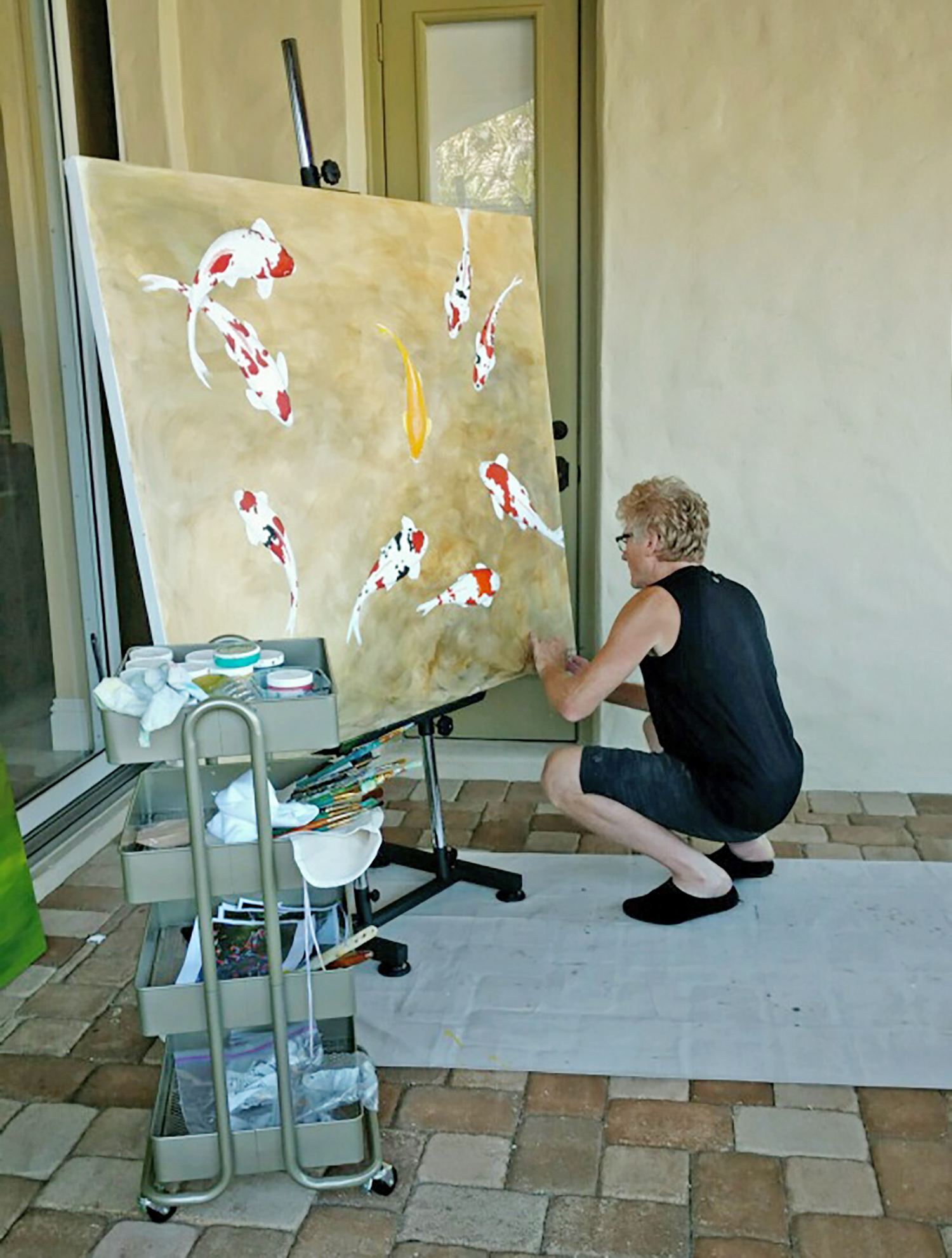 Picture of the artist Derek Olson painting.